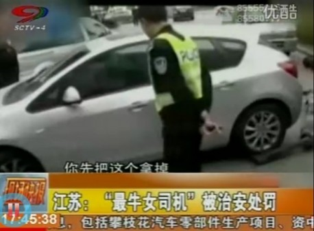 Angry Chinese woman Drives off a Tow truck in China