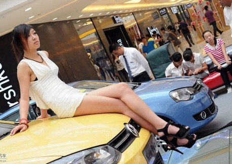 Two Chines Girls and a new Volkswagen Polo