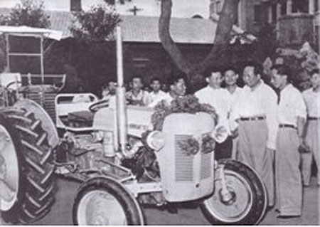 Chairman Mao and a Dragon tractor