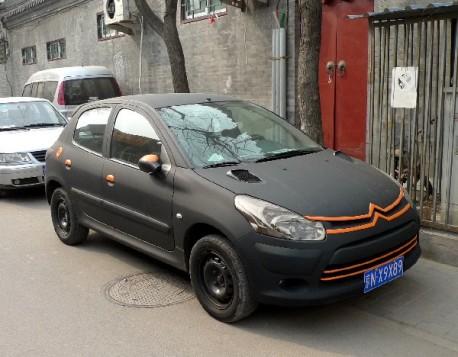 [SUJET OFFICIEL][CHINE] Citroën C2 - Page 2 A-peugeot-207-matte-black-china-1-458x357