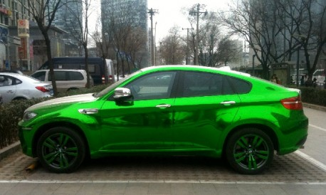 BMW X6M in silver and lime-green