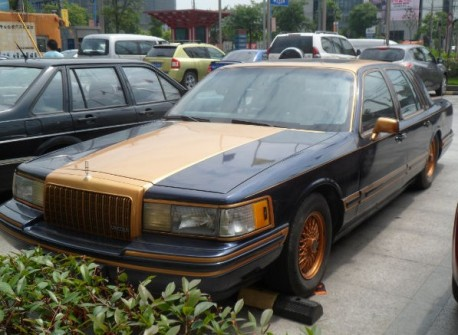 Lincoln Town Car in black and gold-orange