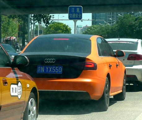 Audi A4L in orange & black in China