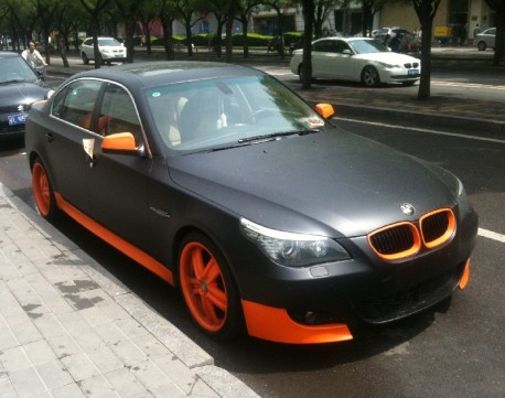 BMW 5 in orange & black in China
