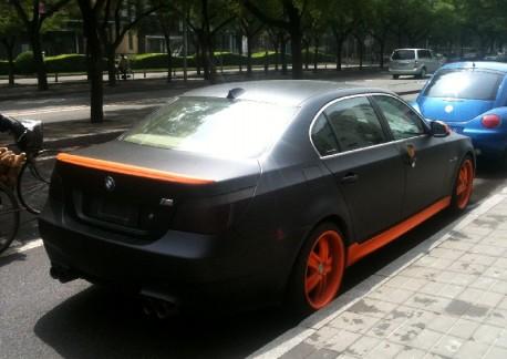BMW 5 in orange & black in China