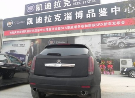 Cadillac SRX in matte-black with blue lights in China