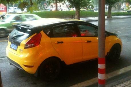 Ford Fiesta in yellow & black in China