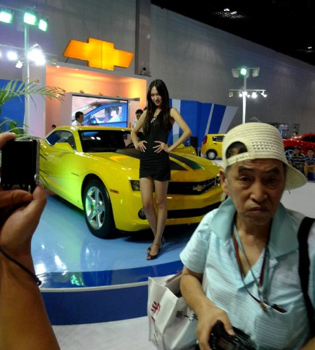 Grumpy old man doesn't like pretty Babe and Camaro