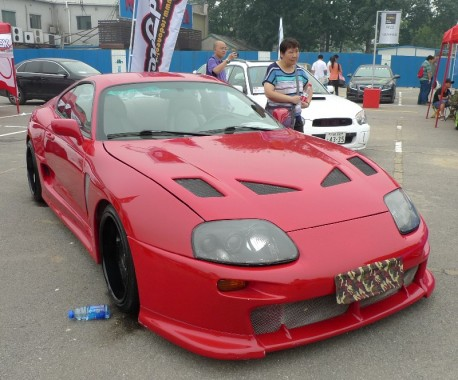 A very red & slightly pimped Toyota Supra in China