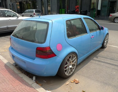 Volkswagen Golf in Blue and some Pink in China