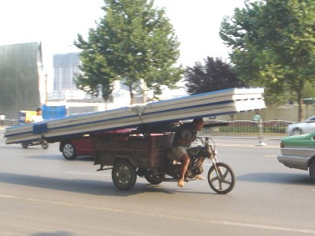 Transporting roof panels on a Triycle in China
