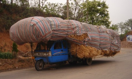 A slightly overloaded motorized tricycle in China