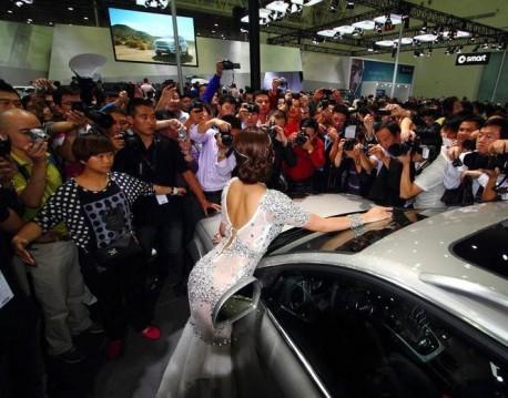 Cao Yang sells an Audi in China