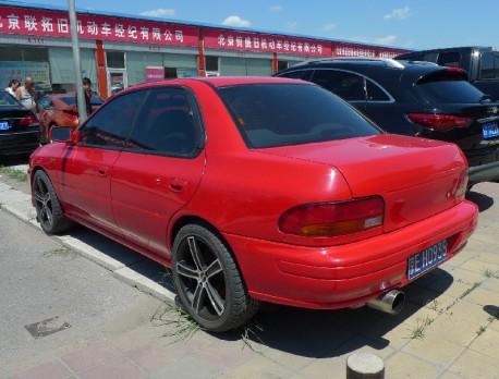 Spotted in China: rare GC8C Subaru Impreza WRX in Red