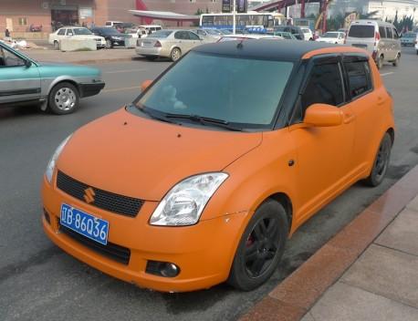 Suzuki Swift is matte orange in China
