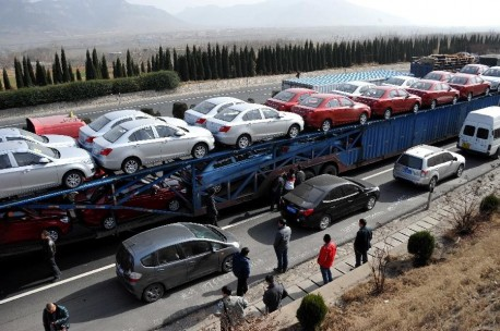 Sixteen cars on top of a Truck in China
