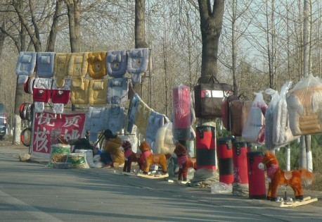 Selling seat covers & rocking horses along the Road in China