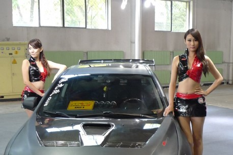 Two sweet girls & a Mitsubishi EVO X in China