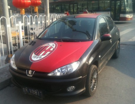 Chinese man is a Milan fan in a Peugeot 207