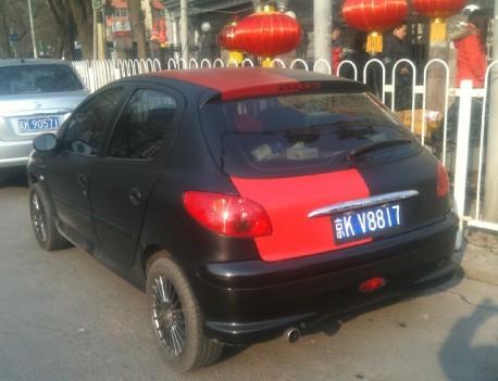 Chinese man is a Milan fan in a Peugeot 207
