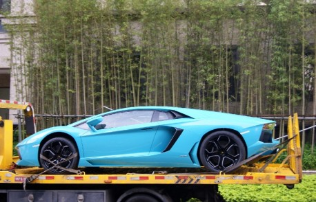 Baby Blue Lamborghini Aventador on a Truck in China