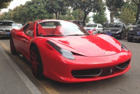 Ferrari 458 Spider is Red with a bit of Pink in China