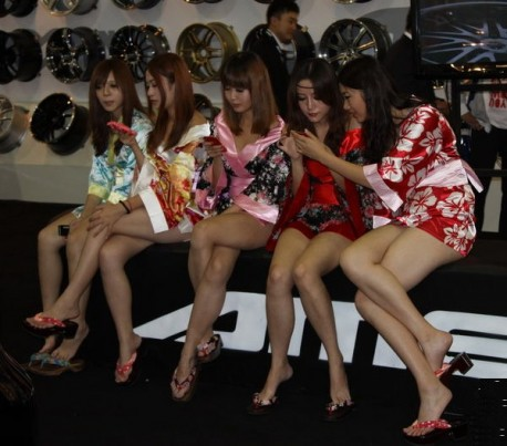 Girls get Bored at the Auto Show in China