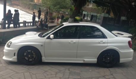 Subaru Impreza WRX STi is White with a body kit in China