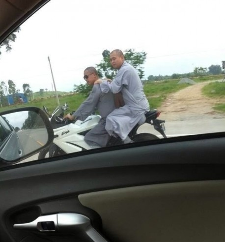 Praying hard and Riding Fast; Chinese Monks on a Kawasaki Ninja motorbike