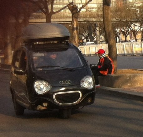Black tricycle thinks it is an Audi in China