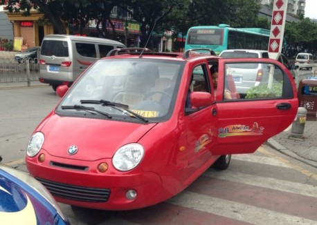 Red tricycle thinks it is a BMW in China