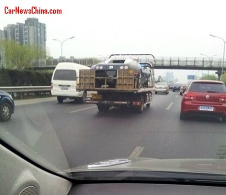 Bugatti Veyron on the back of a truck in China