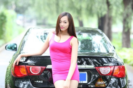 Cute Chinese girl in Pink gets very Close to a Toyota Reiz