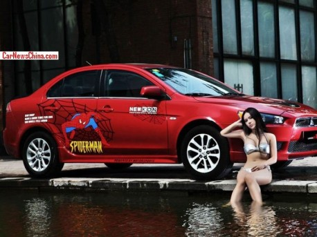 Sweet Chinese Girl is very Spiderman with a Mitsubishi Lancer EX