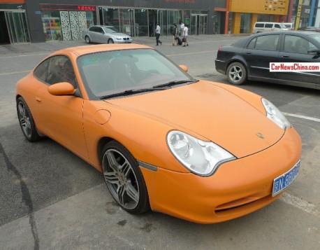 Porsche 911 Carrera 4 is matte orange in China