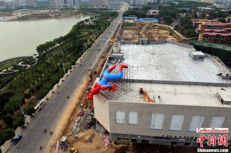 Giant inflatable Spiderman watches over the Road in China
