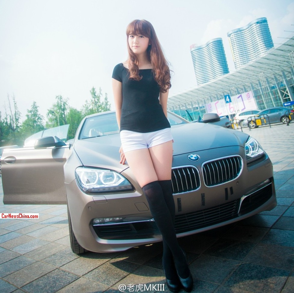 Pretty Chinese Girl with Long Legs checks out a BMW 6 Series Gran Coupe
