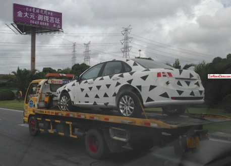 Spy Shots: lightly camouflaged Buick Excelle on a Truck in China