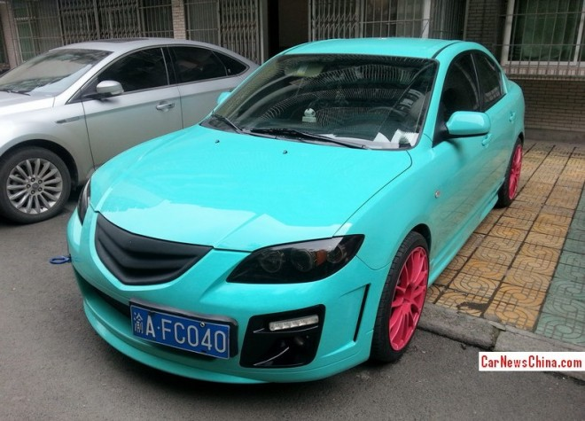 Mazda 3 sedan is Turquoise with Pink alloys in China