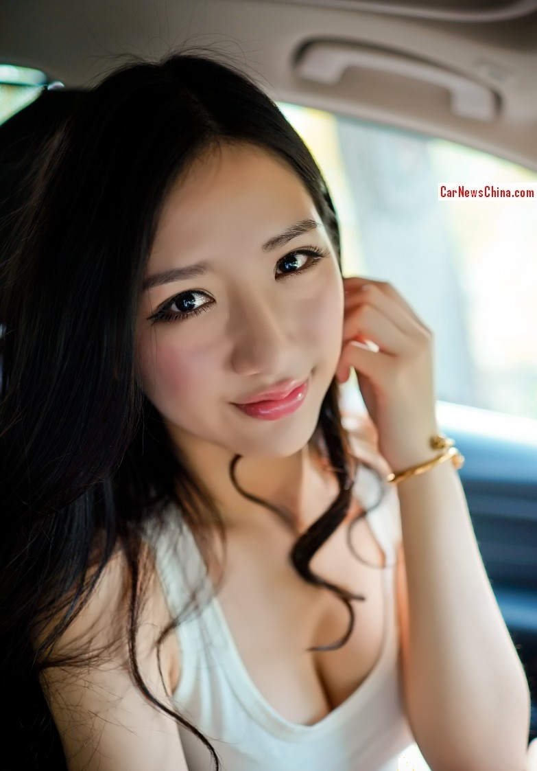 Pretty Chinese Girl Is Very Happy With BMW 320Li