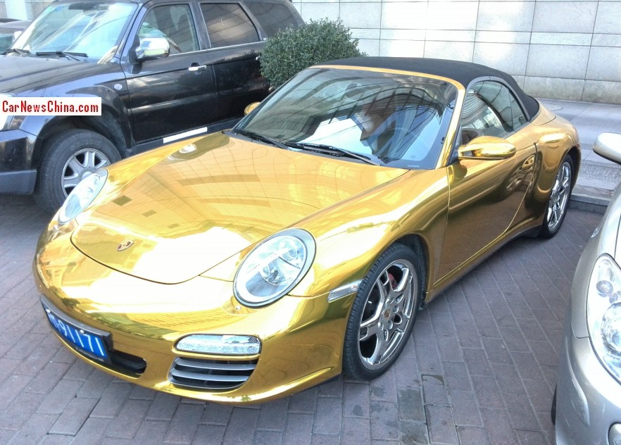 Porsche 911 Cabriolet Is Shiny Gold With A License In
