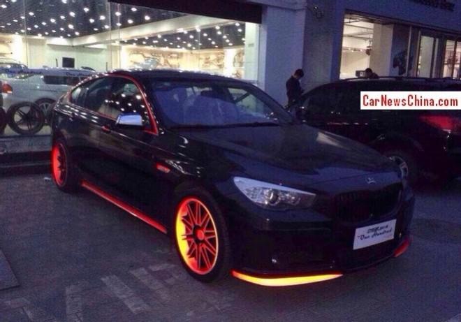 BMW 5 Series GT is black, orange, and fluorescent orange in China