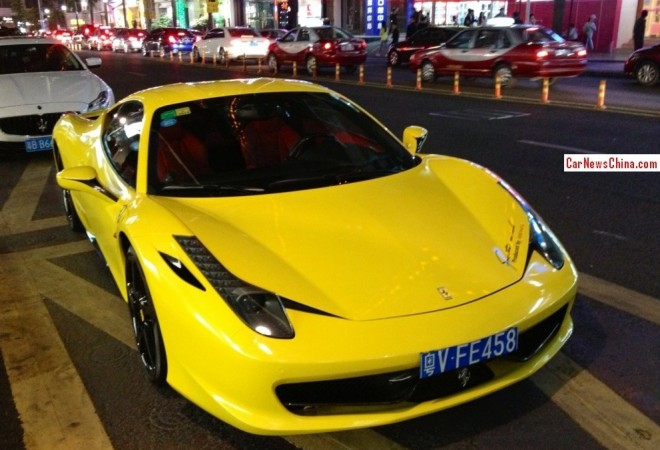 Ferrari 458 is banana yellow with a License in China