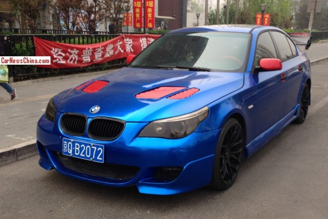 BMW 5-Series sedan is shiny blue with a Bit of Pink in China