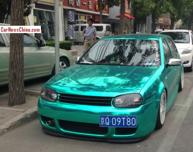 Volkswagen Golf is a shiny green low rider in China