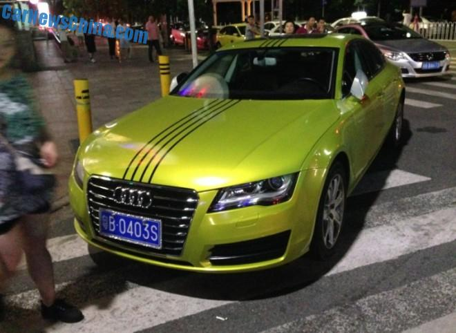 Audi A7 is mustard-yellow-gold with black stripes in China