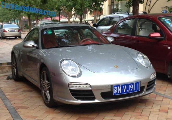 Porsche 911 is silver gray with a License in China