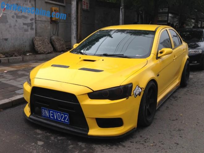 Mitsubishi Lancer EVO X is a banana yellow Low Rider in China