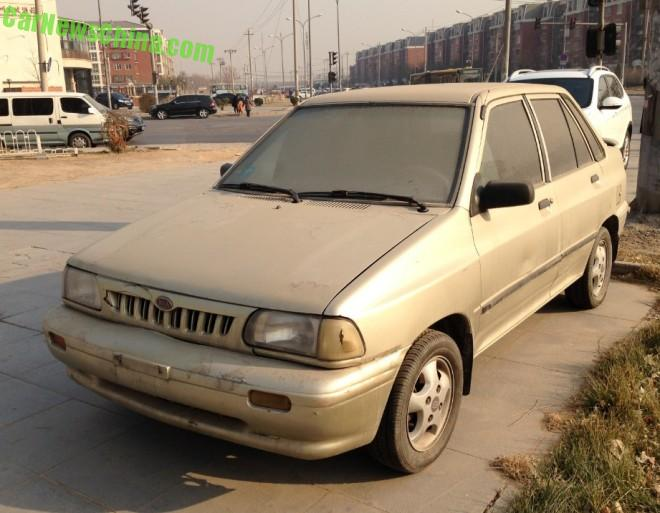 Spotted in China: a dusty Kia Pride sedan