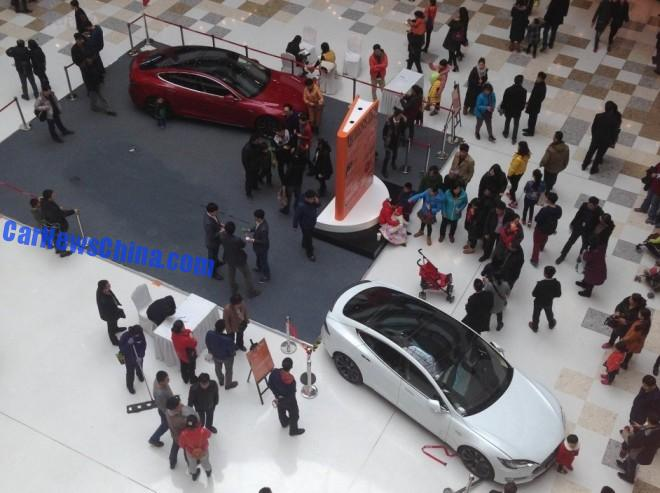 Five-year old Kid starts Tesla Model S in a shopping mall in China, hits a baby